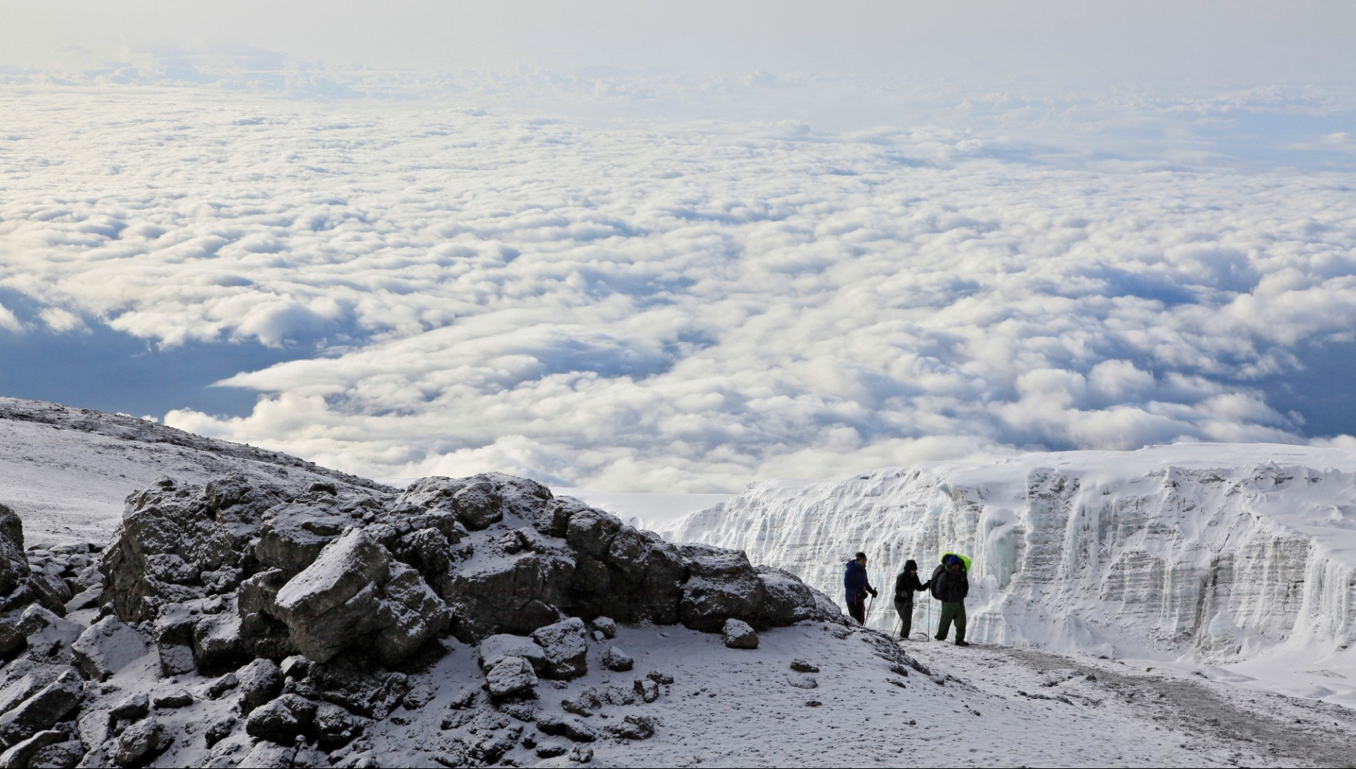 Climbers ascending the crater rim of Mt. Kilimanjaro, up from Stella Point, as seen from the summit area.